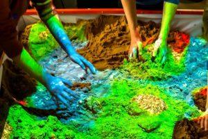 kids playing in interactive sandbox