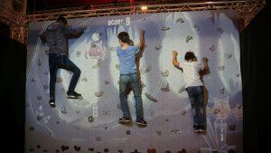 3 kids having fun on interactive climbing wall valo climb