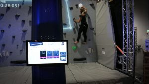 woman climbing in interactive labyrinth on valo climb